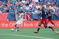 FOXBOROUGH, MA - JULY 25: Djordje Mihailovic #8 of CF Montreal passes the ball near the New England Revolution goal during a game between CF Montreal and New England Revolution at Gillette Stadium on July 25, 2021 in Foxborough, Massachusetts.