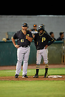 Bristol Pirates shortstop Victor Ngoepe (5) talks with manager Miguel Perez (41) during the second game of a doubleheader against the Bluefield Blue Jays on July 25, 2018 at Bowen Field in Bluefield, Virginia.  Bristol defeated Bluefield 5-2.  (Mike Janes/Four Seam Images)