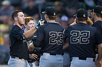 Ben Breazeale (39) of the Wake Forest Demon Deacons is congratulated by his teammates after hitting a home run against the West Virginia Mountaineers in Game Six of the Winston-Salem Regional in the 2017 College World Series at David F. Couch Ballpark on June 4, 2017 in Winston-Salem, North Carolina.  The Demon Deacons defeated the Mountaineers 12-8.  (Brian Westerholt/Four Seam Images)