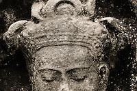 UNESCO World Heritage Site,  Ankgor wat temples . Gautama Buddha sculpture.   Seam Reap, Cambodia.