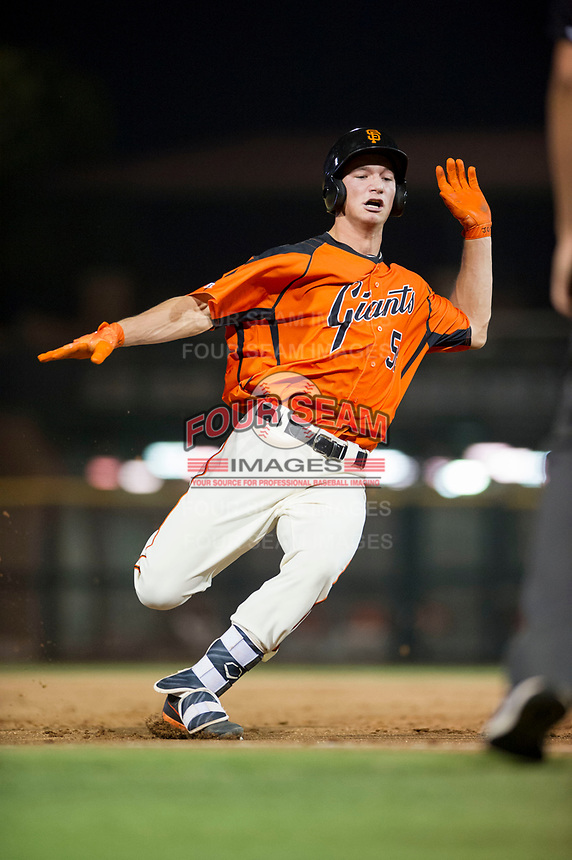 AZL Giants third baseman Jacob Gonzalez (52) prepares to slide into third base against the AZL Cubs on September 5, 2017 at Scottsdale Stadium in Scottsdale, Arizona. AZL Cubs defeated the AZL Giants 10-4 to take a 1-0 lead in the Arizona League Championship Series. (Zachary Lucy/Four Seam Images)