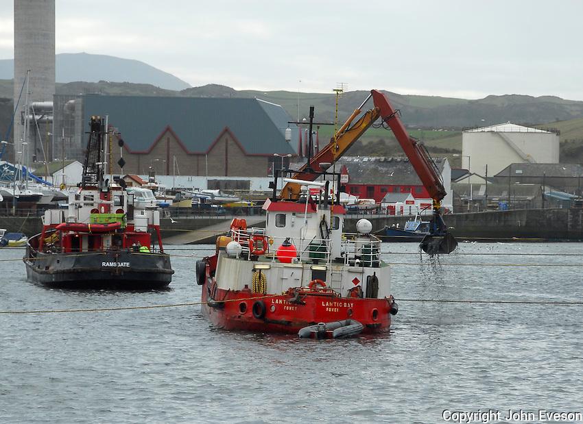 Dredging the harbour, Peel, Isle of Man.