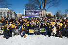 "Jan. 22, 2014; Students gather for a photo under the Notre Dame ""Right for Life"" banner before the 2014 March for Life in Washington, DC. Photo by Barbara Johnston/University of Notre Dame"