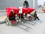 Three Chinese rickshaws with Chinese man.