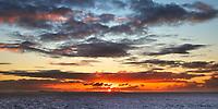 Colorful sunset on Sint Maarten (Saint Martin) island from the sea, in the Caribbean Leeward Islands, North America