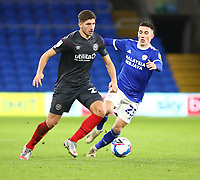 26th December 2020; Cardiff City Stadium, Cardiff, Glamorgan, Wales; English Football League Championship Football, Cardiff City versus Brentford; Vitaly Janelt of Brentford looks to play the ball as Harry Wilson of Cardiff City pressures from behind