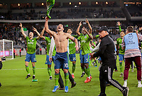 LOS ANGELES, CA - OCTOBER 29: Nicolas Lodeiro #10 of Seattle Sounders FC celebrate their MLS Western Conference victory by defeating Los Angeles FC 3-1 during a game between Seattle Sounders FC and Los Angeles FC at Banc of California Stadium on October 29, 2019 in Los Angeles, California.
