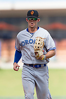 Surprise Saguaros left fielder Cavan Biggio (26), of the Toronto Blue Jays organization, jogs off the field between innings of an Arizona Fall League game against the Salt River Rafters at Salt River Fields at Talking Stick on October 23, 2018 in Scottsdale, Arizona. Salt River defeated Surprise 7-5 . (Zachary Lucy/Four Seam Images)