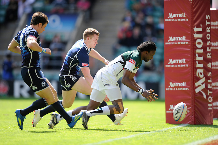 Gardener Nechironga of Zimbabwe scores a try against Scotland during the iRB Marriott London Sevens at Twickenham on Sunday 13th May 2012 (Photo by Rob Munro)