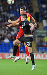 14th August 2013 - Cardiff - UK : Wales v Republic of Ireland - Vauxhall International Friendly at Cardiff City Stadium :  Sam Vokes of Wales challenges Ciaran Clark of Ireland.