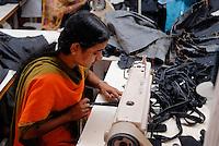 BANGLADESH, textile industry in Dhaka, company Beximco produce Denim trouser for export for western discounter / BANGLADESH, Textilbetrieb Beximco in Dhaka produziert Jeanshosen fuer den Export fuer westliche Textildiscounter u.a. Tom Tailor