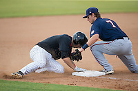 John Ziznewski (5) of the Kannapolis Intimidators is tagged out by Hagerstown Suns third baseman David Masters (7) as he tried to stretch a double into a triple at CMC-Northeast Stadium on July 19, 2015 in Kannapolis, North Carolina.  The Suns defeated the Intimidators 9-4.  (Brian Westerholt/Four Seam Images)