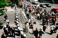 Montreal (Qc) CANADA - May 25 1998<br /> -File Photo -<br /> <br /> Policemen with riot gear stand along the barricaded perimenter that surround the Sheraton Center in downtown during the 1998 Conference of Montreal.<br /> <br /> <br /> PHOTO :  Agence Quebec Presse