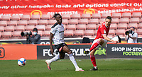 24th April 2021, Oakwell Stadium, Barnsley, Yorkshire, England; English Football League Championship Football, Barnsley FC versus Rotherham United; Jordan Williams of Barnsley clears under pressure from Chiedozie Ogbene of Rotherham