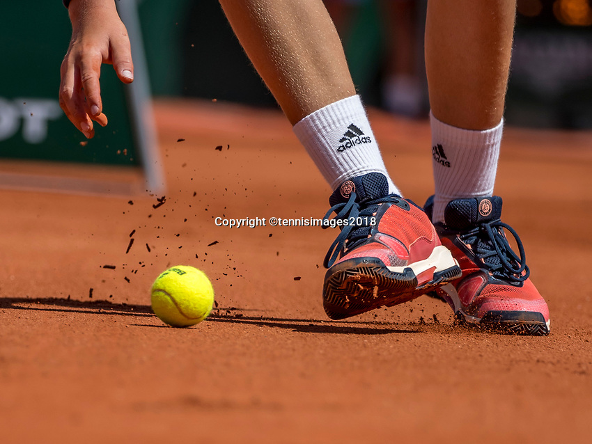 Paris, France, 27 May, 2018, Tennis, French Open, Roland Garros, ballboy picking up Roland Garros tennis ball<br /> Photo: Henk Koster/tennisimages.com