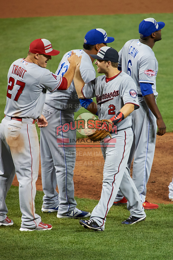 Minnesota Twins Brian Dozier high fives Los Angeles Angels Mike Trout after closing out the MLB All-Star Game on July 14, 2015 at Great American Ball Park in Cincinnati, Ohio.  (Mike Janes/Four Seam Images)