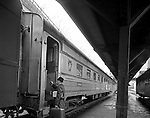 Pittsburgh PA:  Businessman boarding a passenger commuter train at Pittsburgh's Penn Station.