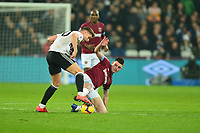Declan Rice of West Ham United tackles Tom Cairney of Fulham during West Ham United vs Fulham, Premier League Football at The London Stadium on 22nd February 2019