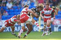 Marland Yarde of London Irish is tackled by Dan Robson (centre) and Billy Twelvetrees of Gloucester Rugby during the Aviva Premiership match between London Irish and Gloucester Rugby at the Madejski Stadium on Saturday 8th September 2012 (Photo by Rob Munro)