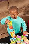 Two year old toddler boy making block tower