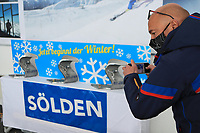16th October 2020, Rettenbachferner, Soelden, Austria; FIS World Cup Alpine Skiing course set up; Alpine Ski World Cup 2020-2021 - during the Coronavirus Outbreak . One day before the Giant Slalom as part of the Alpine Ski World Cup in Solden; A man wearing a protective mask takes a pictures of the trophies