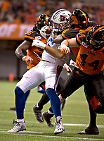 Vancouver, September, 09, 2016 - Alouette Jean-Christophe Beaulieu [Centre] struggles to hold on to the ball. The Montreal Alouettes lost to the BC Lions 27-38. (Andrew Soong)