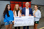 Three Churchill ladies who raised €650 from a bake sale to support the Churchill Forge Heritage Centre, present it to Dermot Crowley ogf the Heritage Centre on Tuesday. L to r: Aoife Greaney, Molly McDaid, Lisa Cassidy and Dermot Crowley (Heritage Centre).