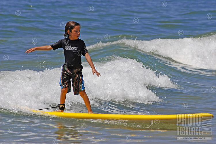 Young boy surfing, Kauai