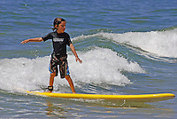 Young boy surfing, Kauai