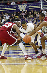 DeAngelo Casto (#23) and Marcus Capers, WSU true freshmen, apply defensive pressure to fellow true freshman, Isaiah Thomas, during the Cougars Pac-10 conference showdown with the University of Washington on March 7, 2009, in Seattle, Washington.  Both teams came in to the game on a roll, and in a hard fought battle, the Huskies prevailed 67-60 to wrap up the regular season Pac-10 championship.
