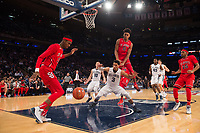 NEW YORK, NY - Thursday March 9, 2017: Malik Ellison (#0) of St. John's fouls Josh Hart (#3) of Villanova as the two schools square off in the Quarterfinals of the Big East Tournament at Madison Square Garden.