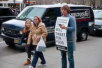 Unemployed social media strategist Hagan Blount on 5th avenue standing with mobile phone and sending tweets