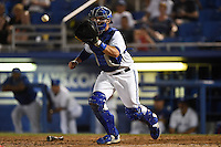 Dunedin Blue Jays catcher Mike Reeves (23) takes a throw while in a rundown during a game against the Clearwater Threshers on April 10, 2015 at Florida Auto Exchange Stadium in Dunedin, Florida.  Clearwater defeated Dunedin 2-0.  (Mike Janes/Four Seam Images)
