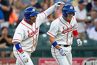 Wearing an Austin Senators throwback uniform, Round Rock Express designated hitter Manny Ramirez (39) congratulates teammate Jim Adduci (24) after his second inning home run during the Pacific Coast League baseball game against the Oklahoma City RedHawks on July 9, 2013 at the Dell Diamond in Round Rock, Texas. Round Rock defeated Oklahoma City 11-8. (Andrew Woolley/Four Seam Images)