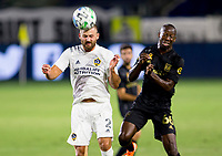 CARSON, CA - SEPTEMBER 06: Perry Kitchen #2 of Los Angeles Galaxy heads a ball during a game between Los Angeles FC and Los Angeles Galaxy at Dignity Health Sports Park on September 06, 2020 in Carson, California.