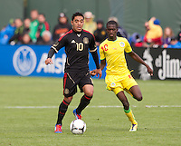 San Francisco, California - Saturday March 17, 2012: Marco Fabian and Souleymane Cisse in action during the Mexico vs Senegal U23 in final Olympic qualifying tuneup. Mexico defeated Senegal 2-1