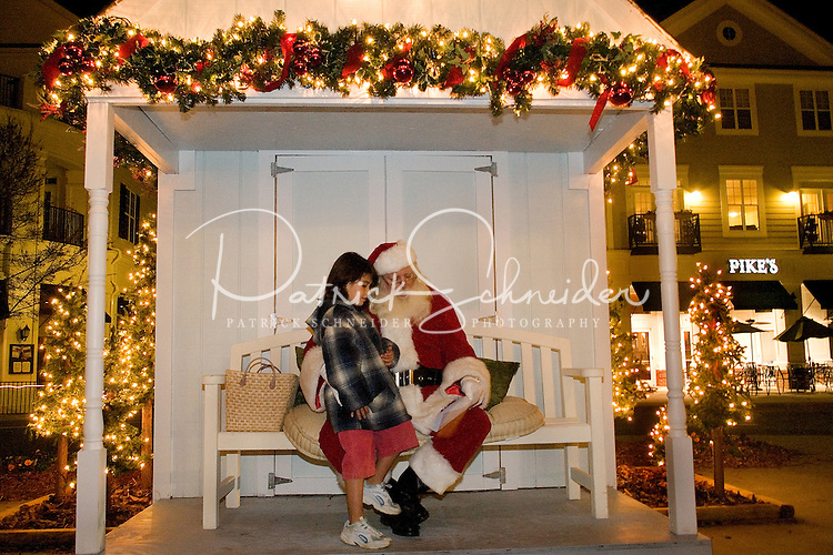A girl goes over her wish list with Santa during the annual Christmas tree lighting event at Birkdale Village in Huntersville, NC. Birkdale Village combines the best of shopping, dining, apartments and entertainment venues within a 52-acre mixed-use development.