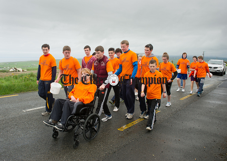 Transition year students from around the county supported Nicole Norton on a 50k charity wheelchair push in aid of Clare Crusaders in North Clare last weekend. Our picture shows the group enroute heading from Doolin towards the Cliffs of Moher. Photograph by John kelly.