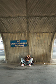Young man sleeping under the Marylebone flyover in central London.