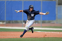 Outfielder Mike O'Neill (14) of the New York Yankees organization during a minor league spring training game against the Toronto Blue Jays on March 16, 2014 at the Englebert Minor League Complex in Dunedin, Florida.  (Mike Janes/Four Seam Images)
