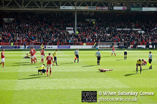 Nottingham Forest 1 Birmingham City 0, 19/04/2014. City Ground, Championship. Exhausted players from both team at the end of the Championship fixture between Nottingham Forest and Birmingham City from the City Ground. Nottingham Forest won the game 1-0.  Photo by Simon Gill.