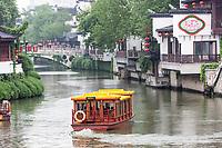 Nanjing, Jiangsu, China.  Tourist Boat on the Qinhuai River in the Rain, Confucius Temple Area.