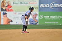 Carlos Alonzo (17) of the Reading Fightin Phils leads off second base during a game against the New Britain Rock Cats at New Britain Stadium on July 13, 2014 in New Britain, Connecticut. Reading defeated New Britain 6-4.  (Gregory Vasil/Four Seam Images)