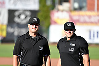 First base umpire Colin Baron and home plate umpire Jake Bruner before the game between the Orem Owlz and Ogden Raptors in Pioneer League action at Lindquist Field on June 22, 2017 in Ogden, Utah. The Owlz defeated the Raptors 13-8.  (Stephen Smith/Four Seam Images)