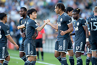 CARSON, CA - SEPTEMBER 29: Hwang In-Beom #4 and Theo Bair #50 of the Vancouver Whitecaps celebrate during a game between Vancouver Whitecaps and Los Angeles Galaxy at Dignity Health Sports Park on September 29, 2019 in Carson, California.