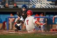 Batavia Muckdogs catcher Jared Barnes (26) attempts to tag Jonathan Pryor (7) sliding into home safely during a game against the Auburn Doubledays on August 26, 2017 at Dwyer Stadium in Batavia, New York.  Batavia defeated Auburn 5-4.  (Mike Janes/Four Seam Images)