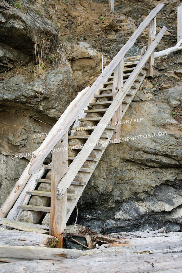 A rustic set of wooden stairs provides access to a private beach on Orcas Island.
