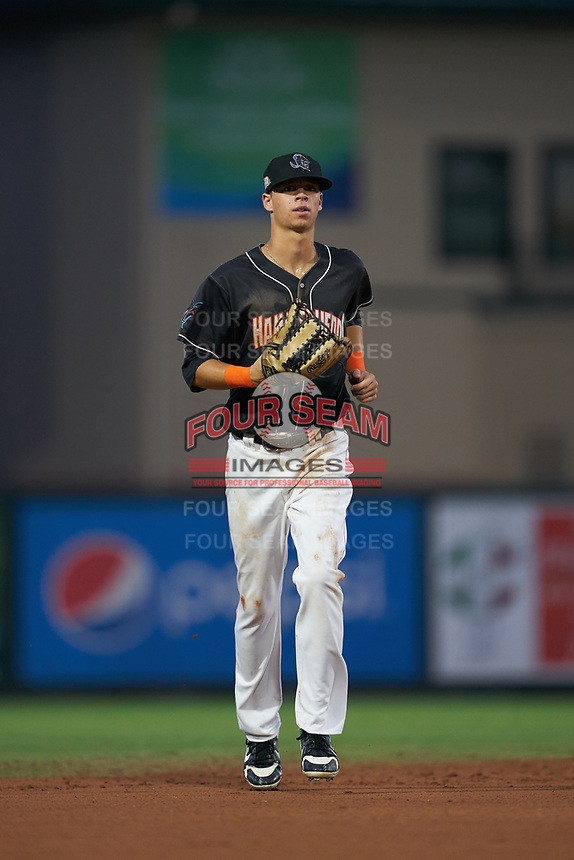 Jupiter Hammerheads center fielder Connor Scott (25) jogs to the dugout during a Florida State League game against the Lakeland Flying Tigers on August 12, 2019 at Roger Dean Chevrolet Stadium in Jupiter, Florida.  Jupiter defeated Lakeland 9-3.  (Mike Janes/Four Seam Images)