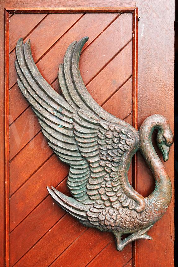 Swan figure on red doorway to St. Columba's Church, Drumcliffe, County Sligo, Republic of Ireland