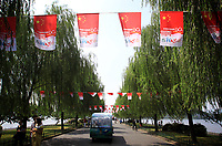 CHINA. Hangzhou. Flags fly near West Lake in the center of the city to celebrate the upcoming 60th anniversary of the founding of the People's Republic of China. 2009